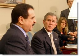 President George W. Bush and King of Bahrain Hamad bin Isa Al Khalifa address the media in the Oval Office Monday, Feb. 3, 2003.   White House photo by Paul Morse