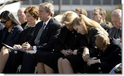 JJoining the family of Space Shuttle Columbia Commander Rick Husband, President George W. Bush and Laura Bush bow their heads in prayer during a memorial service at NASA's Lyndon B. Johnson Space Center Tuesday, Feb. 4, 2003. Sitting with the President are Mr. Husband's wife, Evelyn, and children Laura and Matthew.   White House photo by Paul Morse