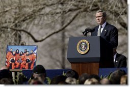 "Speaking to the memory of the seven astronauts who lost their lives in Space Shuttle Columbia disaster, President George W. Bush addresses the nation's loss during a memorial service at the NASA Lyndon B. Johnson Space Center Tuesday, Feb. 4, 2003. ""This cause of exploration and discovery is not an option we choose; it is a desire written in the human heart. We are that part of creation which seeks to understand all creation,"" said the President. ""We find the best among us, send them forth into unmapped darkness, and pray they will return. They go in peace for all mankind, and all mankind is in their debt.""   White House photo by Paul Morse"