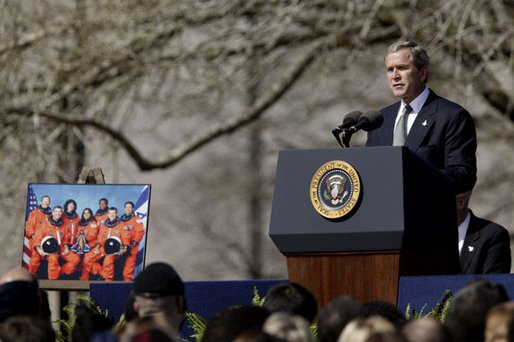 Speaking to the memory of the seven astronauts who lost their lives in Space Shuttle Columbia disaster, President George W. Bush addresses the nation's loss during a memorial service at the NASA Lyndon B. Johnson Space Center Tuesday, Feb. 4, 2003.