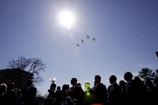 Honoring the seven astronauts who died in the Space Shuttle Columbia disaster, jets fly over the crowd in a missing man formation during a memorial service at the NASA Lyndon B. Johnson Space Center Tuesday, Feb. 4, 2003. White House photo by Paul Morse
