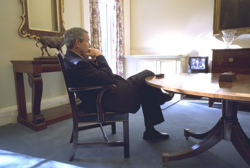 President George W. Bush watches at the White House the broadcast of Secretary of State Colin Powell's address at the United Nations Wednesday, February 5, 2003. White House photo by Eric Draper