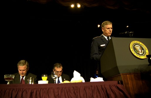 "Led in prayer by the Chairman of the Joint Chiefs of Staff General Richard Myers, President George W. Bush and Congressman Ray LaHood (R-IL) pray during the National Prayer Breakfast in Washington, D.C., Thursday, Feb. 6, 2003. ""In this hour of our country's history, we stand in the need of prayer. We pray for the families that have known recent loss. We pray for the men and women who serve around the world to defend our freedom,"" said the President in his remarks. ""We pray for their families. We pray for wisdom to know and do what is right. And we pray for God's peace in the affairs of men."" White House photo by Eric Draper."