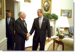President George W. Bush welcomes Australian Prime Minister John Howard to the Oval Office Monday, Feb. 10, 2003. After meeting privately, the two leaders held a joint press conference in which they discussed disarmament in Iraq.   White House photo by Paul Morse