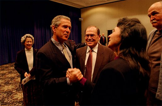 After meeting privately with the leadership and graduates of Campus for Human Development, President George W. Bush talks with program graduates David Barclay, left, LuAnn Nicholas, center, and Bob Head at Opryland in Nashville, Tenn., Feb. 10, 2003. Irene Boyd is pictured in the background. A religious, non-profit organization, The Campus provides a comprehensive support system ranging from shelter for the homeless to drug rehabilitation and job training. White House photo by Tina Hager.