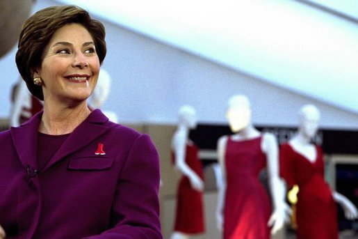Laura Bush participates in media interviews promoting the The Heart Truth / Red Dress Project during fashion week in New York City, Feb. 13, 2003. Behind Mrs. Bush are dresses designed by American fashion designers which will tour the country to raise awareness of heart disease. White House photo by Susan Sterner.
