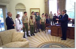 President George W. Bush visits with a delegation from the Boy Scouts of America during the presentation of the annual report by the BSA in the Oval Office Tuesday, Feb. 11, 2003. Participating in the ceremony are, from left, Roy Williams, Emily Petty, Matthew Knight, John Reese, Nick Digirolamo, Sam Stocker, Zachary Gomez, Jonathan Nagata, Bethany Loomis, Jesse Loomis, William Loomis, Carol Pyfer and John Pyfer. White House photo by Eric Draper.