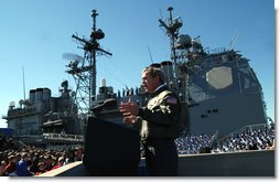 President George W. Bush speaks to sailors in front of the USS Philippine Sea at Naval Station Mayport in Mayport, Fla., Thursday, Feb. 13, 2003.  White House photo by Eric Draper