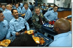 President George W. Bush shares a light moment after lunch with sailors aboard the USS Philippine Sea at Naval Station Mayport in Mayport, Fla., Thursday, Feb. 13, 2003.  White House photo by Eric Draper