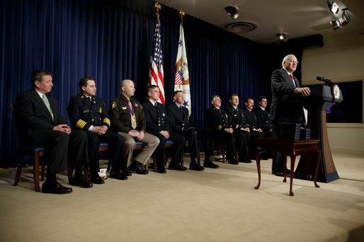 After an introduction by Attorney General John Ashcroft, far left, Vice President Dick Cheney speaks during the Medal of Valor Ceremony in the Dwight D. Eisenhower Executive Office Building Friday, Feb. 14, 2003. The Vice President and Attorney General presented 10 Medals of Valor to public safety officers who put their lives in danger helping people in danger. White House photo by David Bohrer.