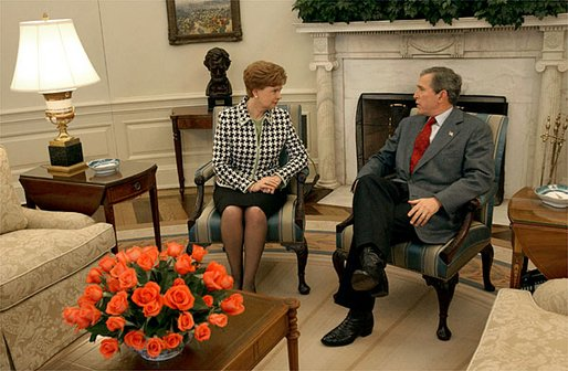 President George W. Bush hosts a visit by Latvian President Vaira Vike-Freiberga in the Oval Office on Presidents' Day, Monday, Feb. 17, 2003. White House photo by Tina Hager.