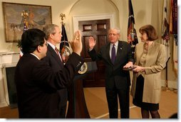 President George W. Bush presides over the swearing-in of William Donaldson as the new chairman of the Securities and Exchange Commission in the Roosevelt Room Tuesday, Feb. 18, 2003.  White House photo by Tina Hager