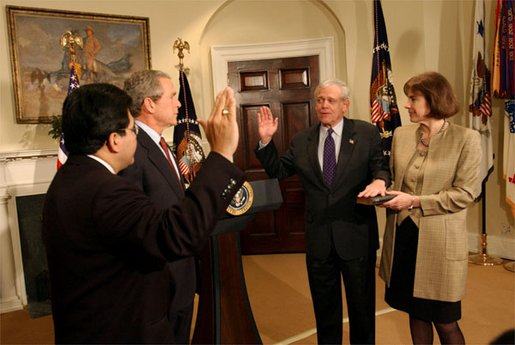 President George W. Bush presides over the swearing-in of William Donaldson as the new chairman of the Securities and Exchange Commission in the Roosevelt Room Tuesday, Feb. 18, 2003. White House photo by Tina Hager.