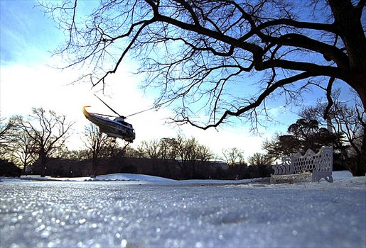 The President's helicopter, Marine One, lifts off from an icy South Lawn as he heads toward Georgia to meet with small business owners Thursday, Jeb. 20, 2003. White House photo by Tina Hager