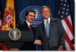 President George W. Bush and President Jose Maria Aznar of Spain shake hands at the end a joint press conference at the Bush Ranch in Crawford, Texas, Saturday, Feb. 22, 2003.  White House photo by Eric Draper