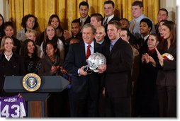 President George W. Bush poses with Andy Groom, captain of Ohio State University's football team, during a visit to the White House by the NCAA Fall Champions Monday, Feb. 24, 2003.   White House photo by Tina Hager