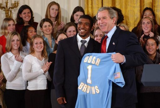 Tony Lawson, captain of the University of California, Los Angeles men's soccer team, presents President George W. Bush with a team jersey during a visit by the NCAA Fall Champions in the East Room Monday, Feb. 24, 2003. White House photo by Tina Hager