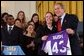 Valerie Fletcher, captain of the women's soccer team at University of Portland, gives President George W. Bush a team jersey during a visit by the NCAA Fall Champions in the East Room Monday, Feb. 24, 2003. White House photo by Tina Hager