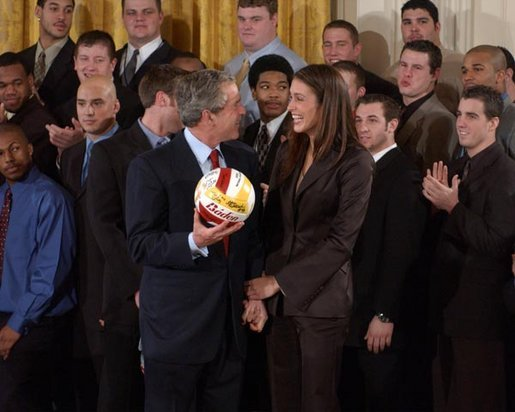 President George W. Bush talks with Lauren Killian, captain of the women's volleyball team at University of Southern California, during a visit by the NCAA Fall Champions to the East Room Monday, Feb. 24, 2003. White House photo by Tina Hager