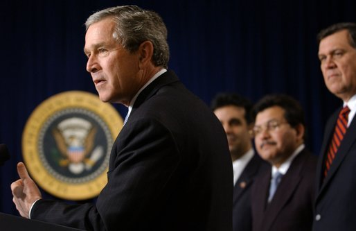 President George W. Bush speaks with The Latino Coalition in the Dwight D. Eisenhower Executive Office Building Wednesday, Feb. 26, 2003. Pictured with the President are Hector Barreto, Small Business Administration Administrator; Alberto Gonzales, Counsel to the President and Mel Martinez, Secretary of Housing and Urban Development. White House photo by Tina Hager