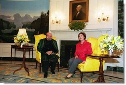Laura Bush welcomes President Hamid Karzai of Afghanistan to the White House during a meeting in the Diplomatic Reception Room Thursday, Feb. 27, 2003.  White House photo by Susan Sterner