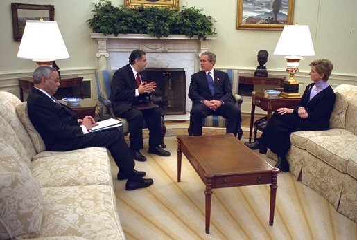 President George W. Bush meets with Secretary of State Colin Powell, left, Secretary of Energy Spencer Abraham, center, and EPA Administrator Christine Todd Whitman in the Oval Office Thursday, Feb. 27, 2003. White House photo by Paul Morse.