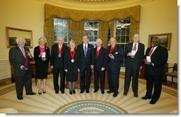 President George W. Bush stands with the recipients of the 2002 National Humanities Medal in the Oval Office Thursday, Feb. 27, 2003. From left, they are: Joseph McDade, who accepts the award on behalf of Frankie Hewitt of Ford's Theatre; Ellen Carroll Walton, who accepts the award on behalf of the Mount Vernon Ladies' Association of the Union; Dr. Donald Kagan of Yale University; author Patricia MacLachlan; Brian Lamb of C-SPAN; Art Linkletter of the United Seniors Association; Frank Conroy, who accepts the award on behalf of the Iowa Writers' Workshop; and Justice Clarence Thomas, who accepts the award on behalf of Dr. Thomas Sowell of the Hoover Institution.  White House photo by Paul Morse