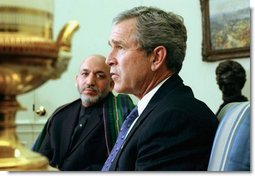 President George W. Bush and President Hamid Karzai of Afghanistan answer questions from the press after a meeting in the Oval Office Thursday, Feb. 27, 2003.  White House photo by Tina Hager