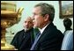 President George W. Bush and President Hamid Karzai of Afghanistan answer questions from the press after a meeting in the Oval Office Thursday, Feb. 27, 2003. White House photo by Tina Hager.