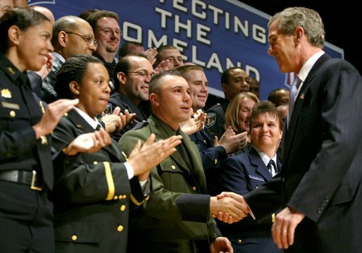 After speaking, President George W. Bush greets a few of the new employees at the U.S. Department of Homeland Security at the Ronald Reagan Building and International Trade Center in Washington, D.C., Friday, Feb. 28, 2003. White House photo by Paul Morse