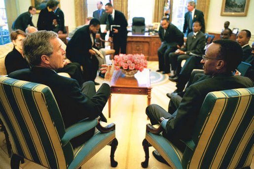 President George W. Bush meets with President Paul Kagame of Rwanda in the Oval Office Tuesday, March 4, 2003. White House photo by Paul Morse