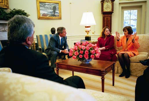 President George W. Bush listens to Dr. Katrin Michael, at right, Della Jaff and Idres Hawarry, foreground, in the Oval Office Friday, March 14, 2003. The three are from the Kurdish area of Iraq where a chemical weapons attack killed 5,000 citizens 15 years ago this weekend. Thousands died in the days following the attack on Halabja and an estimated 10,000 people still suffer from the attack. Idres Hawarry survived the attack on Halabja, Dr. Michael survived a similar attack in another Kurdish village and friends and family of Della Jaff were killed in Halabja. White House photo by Eric Draper.