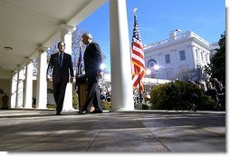 President George W. Bush and Secretary of State Colin Powell walk back to the Oval Office after addressing the media in the Rose Garden Friday, March 14, 2003. The President discussed an outline for peace in the Middle East.  White House photo by Paul Morse