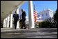 President George W. Bush and Secretary of State Colin Powell walk back to the Oval Office after addressing the media in the Rose Garden Friday, March 14, 2003. The President discussed an outline for peace in the Middle East. White House photo by Paul Morse.