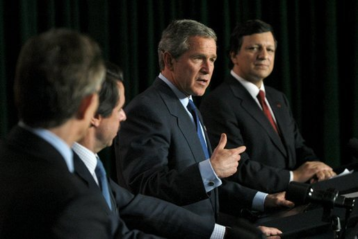 President George W. Bush speaks during a news conference with, from left, Prime Minister of Great Britain Tony Blair, President of Spain Jose Maria Aznar and Prime Minister of Portugal Jose Manuel Durao Barroso in The Azores, Portugal, Sunday, March 16, 2003. White House photo by Eric Draper