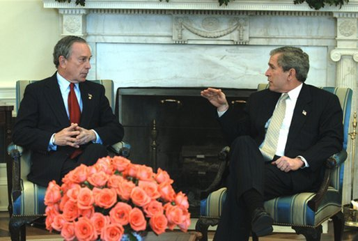 President George W. Bush talks with New York City Mayor Michael Bloomberg in the Oval Office Wednesday, March 19, 2003. Secretary of Homeland Security Tom Ridge, not pictured, also attended the meeting. The President discussed New York's security issues. White House photo by Eric Draper.