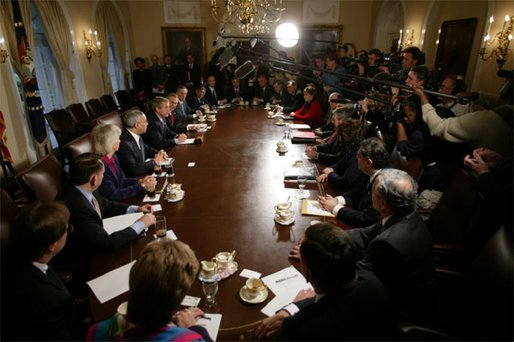 President George W. Bush addresses the media during a meeting with his Cabinet the day after beginning the disarmament of Iraq Thursday, March 20, 2003. White House photo by Paul Morse.