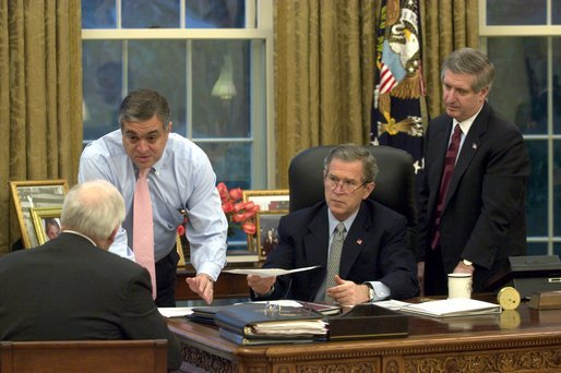 President George W. Bush receives an update on the status of military action in Iraq Thursday morning, March 20, 2003, in the Oval Office. Present are Vice President Dick Cheney, CIA Director George Tenet and Chief of Staff Andy Card. White House photo by Eric Draper