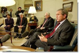 President George W. Bush talks with the press during a meeting with congressional leaders in the Oval Office Friday, March 21, 2003. Pictured with the President are, from left, House Minority Leader Nancy Pelosi, D-Calif., Speaker of the House Dennis Hastert, R-Ill., and Vice President Dick Cheney.   White House photo by Paul Morse