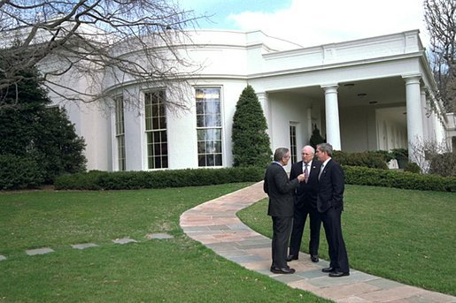 "President George W. Bush meets with Vice President Dick Cheney and Secretary of Defense Donald Rumsfeld outside the Oval Office shortly after authorizing operation ""Iraqi Freedom"" Wednesday morning, March 19, 2003. White House photo by Eric Draper"