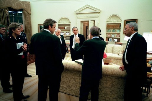 On Wednesday evening, March 19, 2003, President George W. Bush meets with his national security and communications advisors after authorizing military operations. Present, from left, are Steve Hadley, Deputy National Security Advisor; Karen Hughes, special advisor to the President; Chairman of the Joint Chiefs of Staff Richard B. Myers; Dan Bartlett, Communications Director; Vice President Dick Cheney, Secretary of Defense Donald Rumsfeld; National Security Advisor Condoleezza Rice; and Secretary of State Colin Powell. White House photo by Eric Draper.