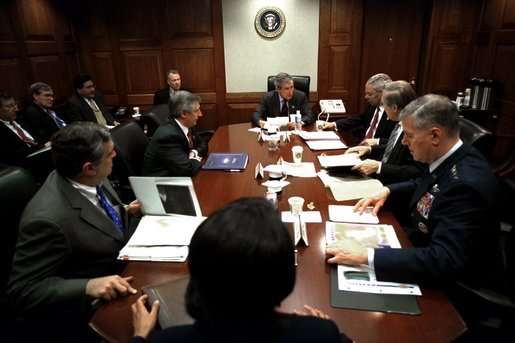 On Friday morning, March 21, 2003, President George W. Bush meets with his war council in the Situation Room of the White House. Present at the table are, from foreground, National Security Advisor Condoleezza Rice, CIA Director George Tenet, Chief of Staff Andy Card, Secretary of State Colin Powell, Secretary of Defense Donald Rumsfeld and Chairman of the Joint Chiefs of Staff Richard B. Myers. White House photo by Eric Draper