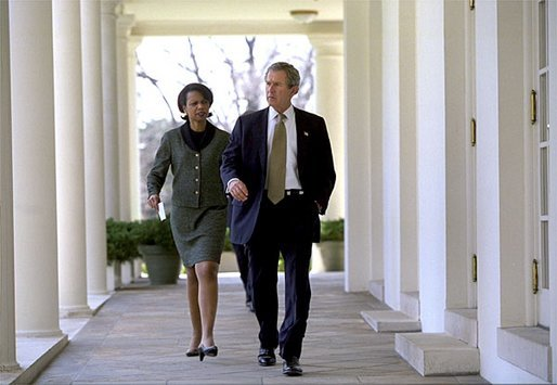 President George W. Bush and National Security Advisor Dr. Condoleezza Rice walk together along the colonnade between the Rose Garden and the Cabinet Room Monday, March 24, 2003. White House photo by Eric Draper.