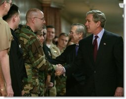 After delivering his remarks, President George W. Bush greets troops at the Pentagon Tuesday, March 25, 2003.  White House photo by Paul Morse