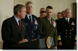President George W. Bush speaks at the Pentagon Tuesday, March 25, 2003. Also pictured, from left, are Chairman of the Joint Chiefs of Staff General Richard B. Myers, Vice Chairman of the Joint Chiefs of Staff General Peter Pace and Chief of Naval Operations Admiral Vern Clark.  White House photo by Paul Morse