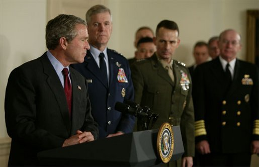 President George W. Bush speaks at the Pentagon Tuesday, March 25, 2003. Also pictured, from left, are Chairman of the Joint Chiefs of Staff General Richard B. Myers, Vice Chairman of the Joint Chiefs of Staff General Peter Pace and Chief of Naval Operations Admiral Vern Clark. White House photo by Paul Morse.