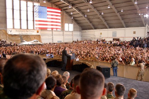 President George W. Bush addresses military personnel inside a hangar at MacDill Air Force Base in Tampa, Florida, Wednesday, March 26, 2003. White House photo by Paul Morse