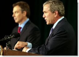 President George W. Bush and British Prime Minister Tony Blair conduct a joint news conference at Camp David concerning the war in Iraq Thursday, March 27, 2003.  White House photo by Paul Morse