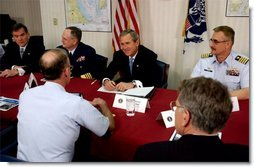 President George W. Bush and Secretary of Homeland Security Tom Ridge, far right, meet with U. S. Coast Guard officers during their visit to the port in Philadelphia Monday, March, 31, 2003.  White House photo by Tina Hager