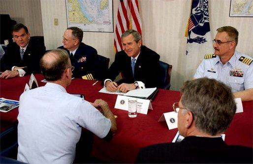 President George W. Bush and Secretary of Homeland Security Tom Ridge, far right, meet with U. S. Coast Guard officers during their visit to the port in Philadelphia Monday, March, 31, 2003. White House photo by Tina Hager.